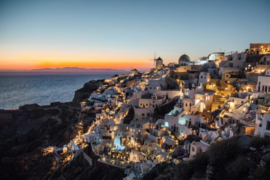Beautiful Santorini lights up for the evening, Cyclades Islands, Greece.