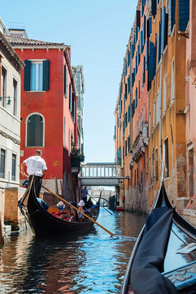 Gliding through the colourful and historic canals of Venice, Italy.