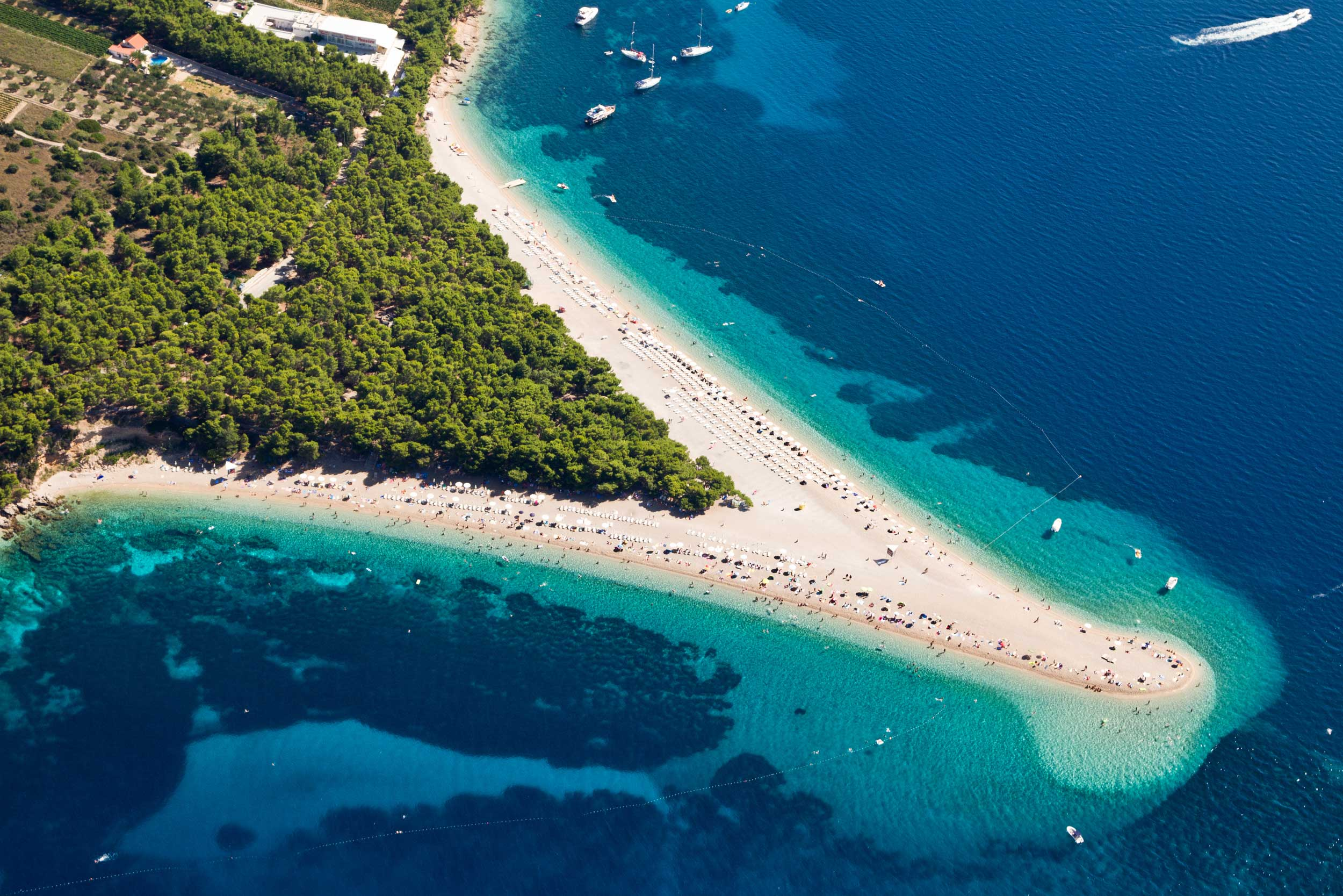 Long narrow V-shaped peninsula with sandy beaches stretching out into azure seas, Croatia