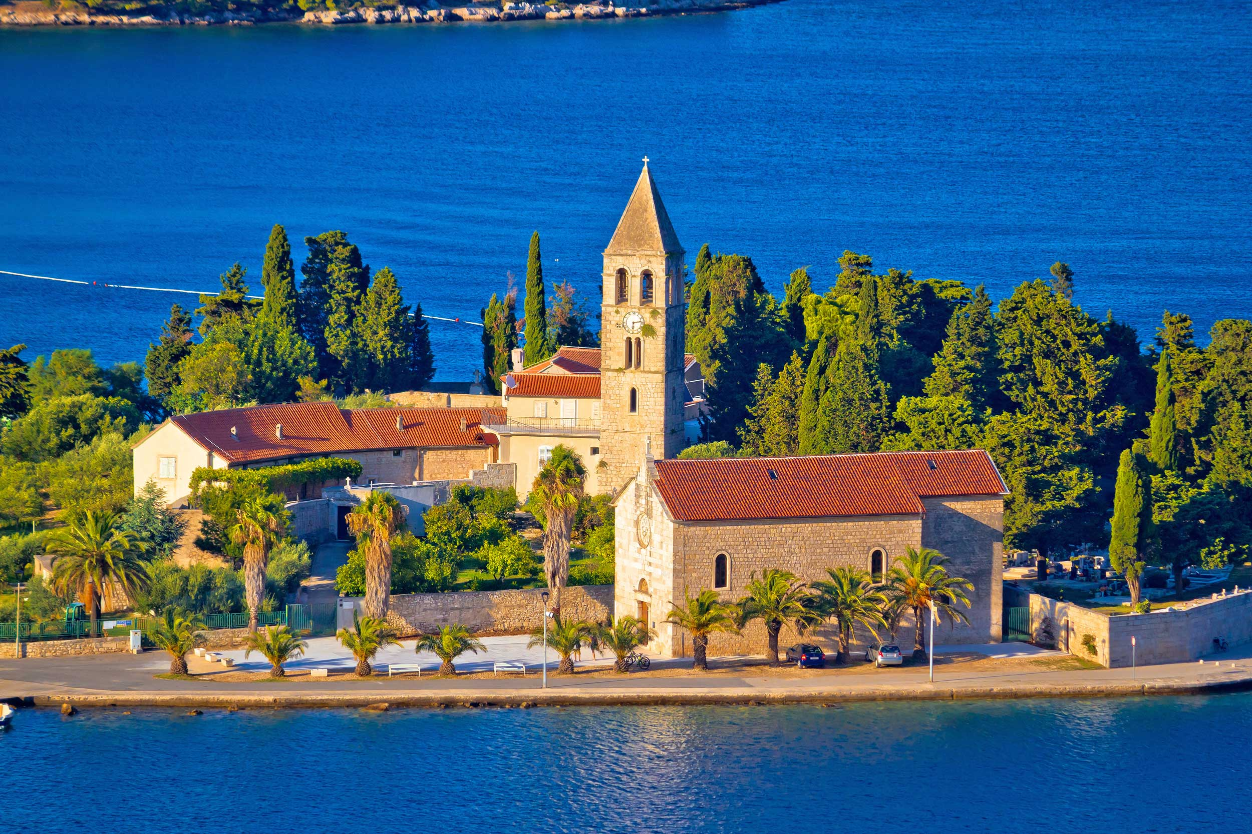 Red-roofed monastery amidst trees on an island, Vis, Croatia