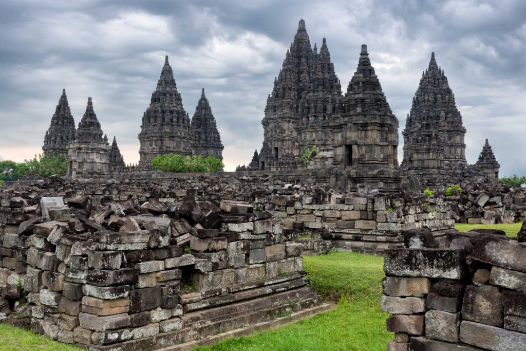 The ancient Prambanan Temple is one of the biggest attractions in Yogyakarta, a city in the center of Java, Indonesia. Its stone architecture, some of which has crumbled and lies stacked around the temple, provides a glimpse into the history of Indonesia.