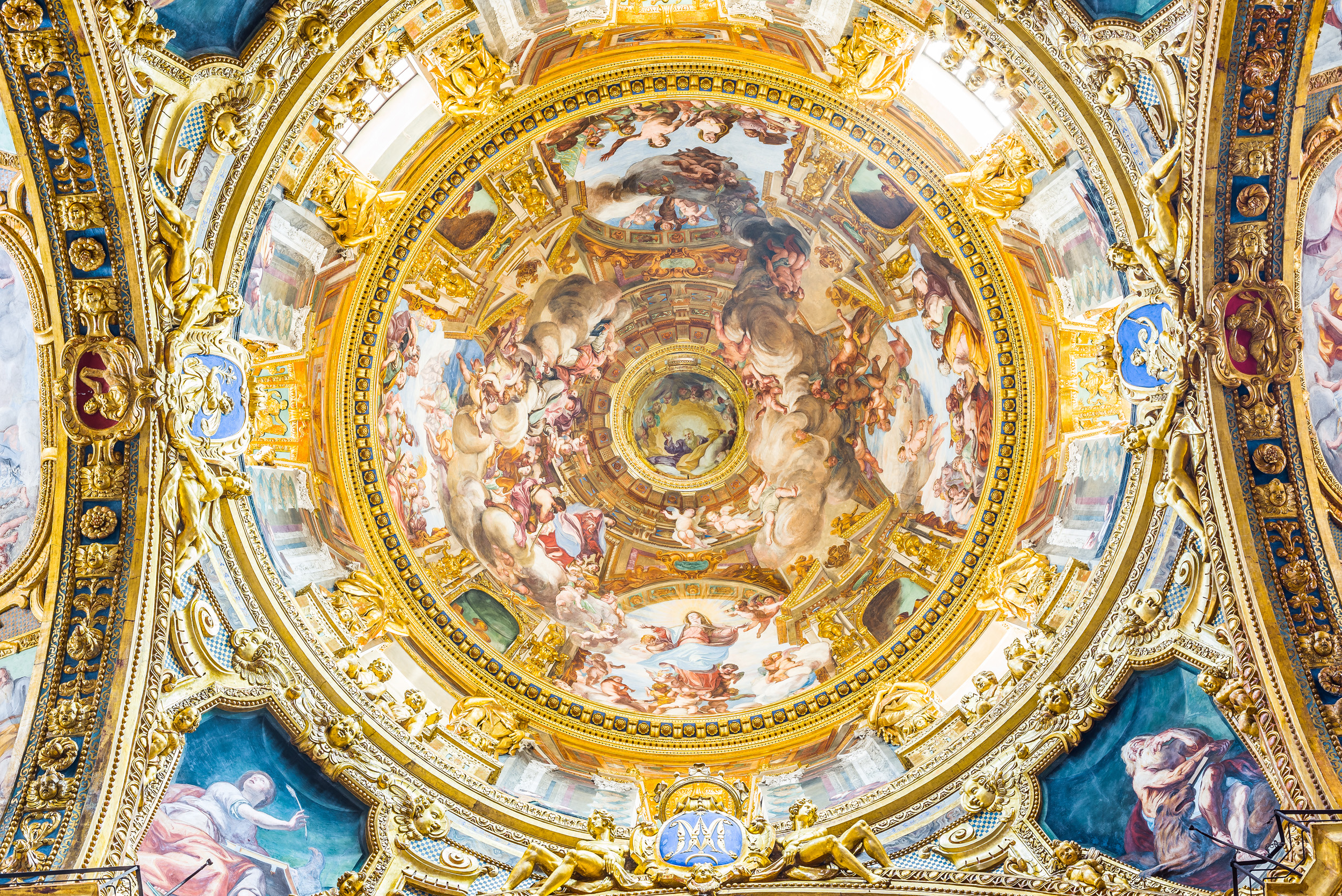 An ornate, gold embossed fresco in a basilica in Genoa, Italy