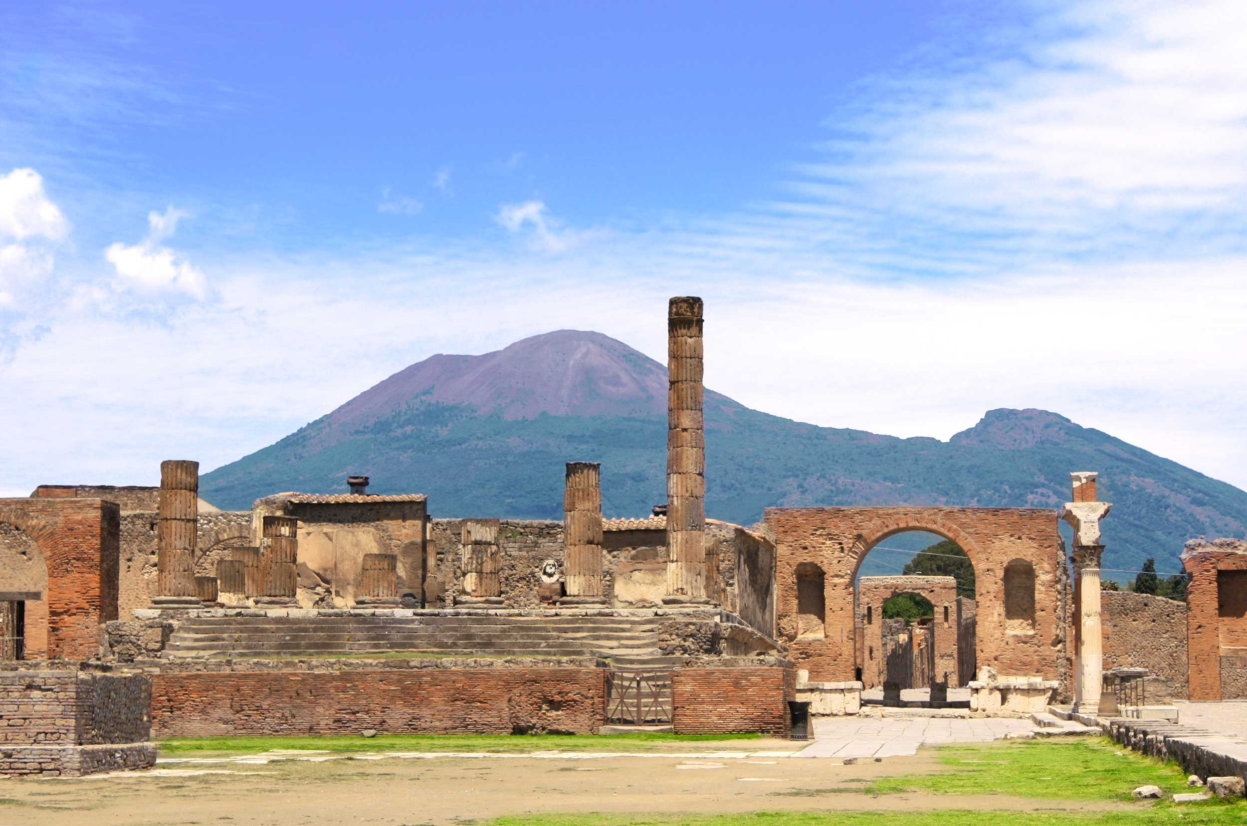 Roman ruins and a volcanic mountain in the background, Pompeii