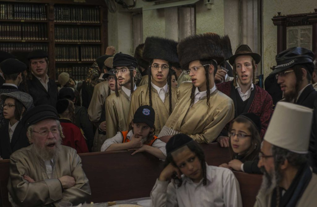 A tish, which means table in Yiddish, is a holy gathering of Hasidim  — extremely orthodox Jews —  around their Rebbe.