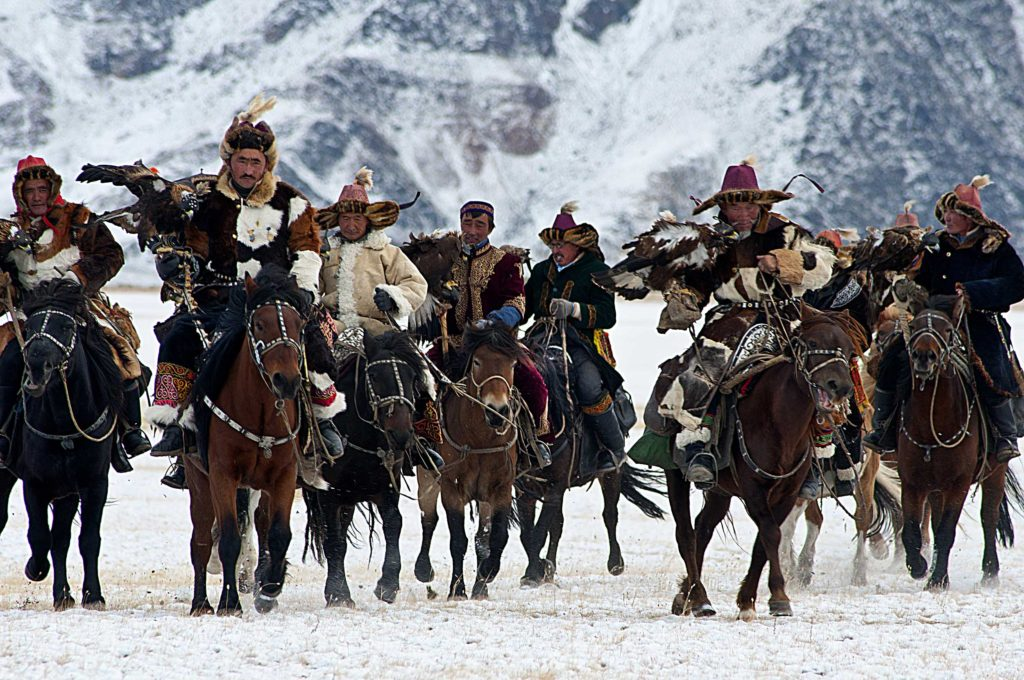 The Golden Eagle Festival in Mongolia celebrates traditional hunting assisted by golden eagles and showcases the skills of the trainers and the eagles.