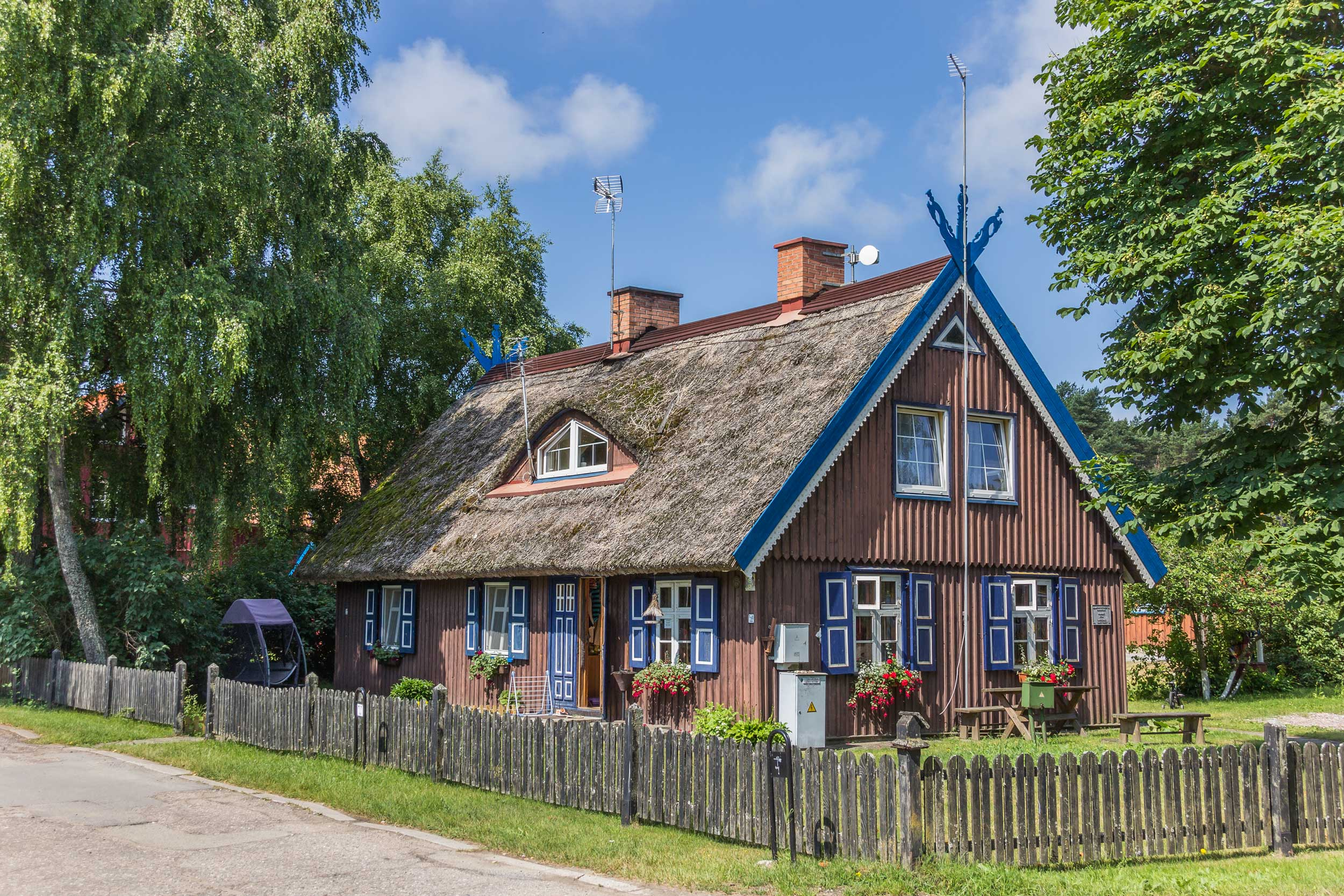 A traditional wooden thatched fisherman's house in Nida, Lithuania