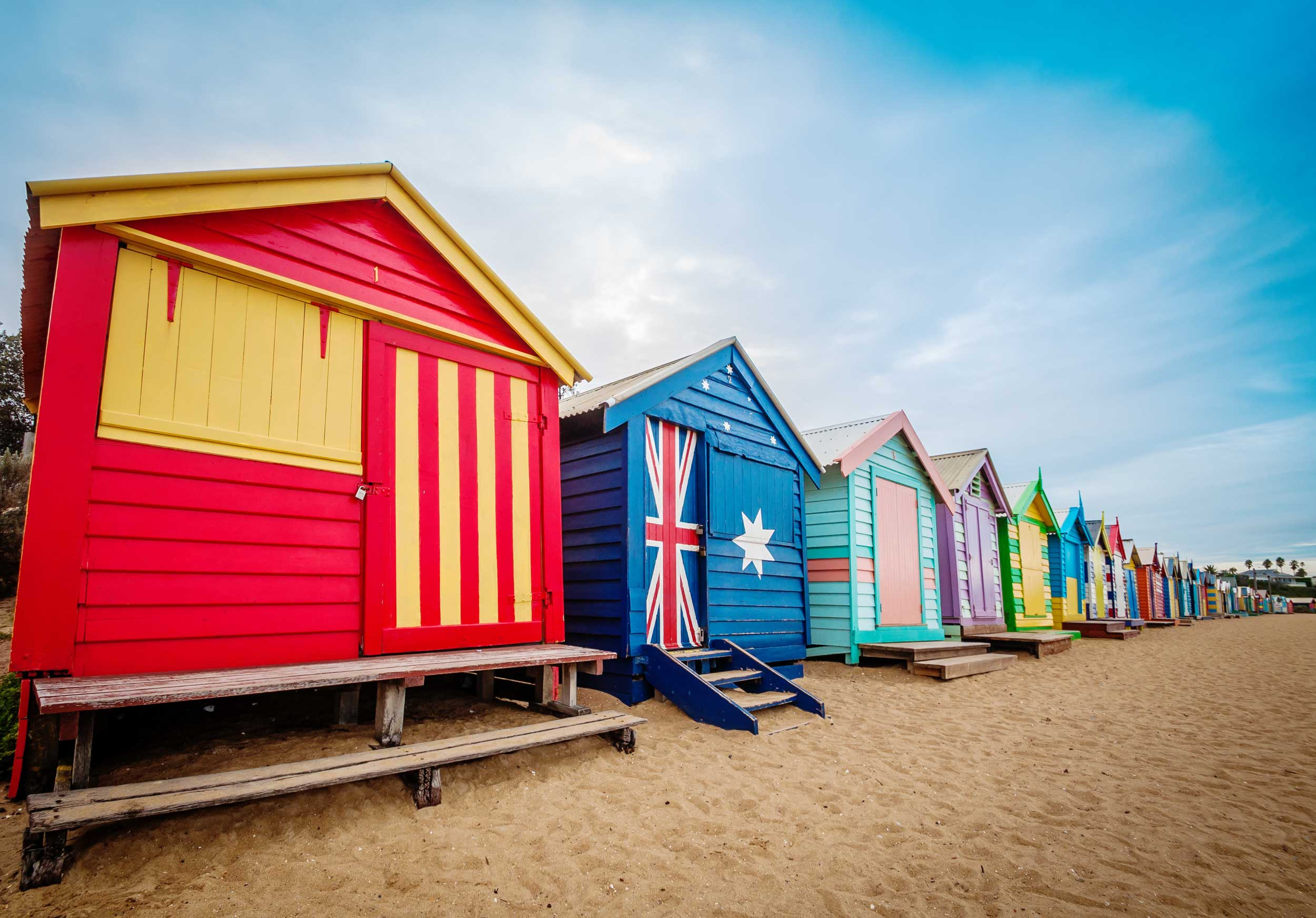 Colourful huts in a row down the beach, Brighton, Australia