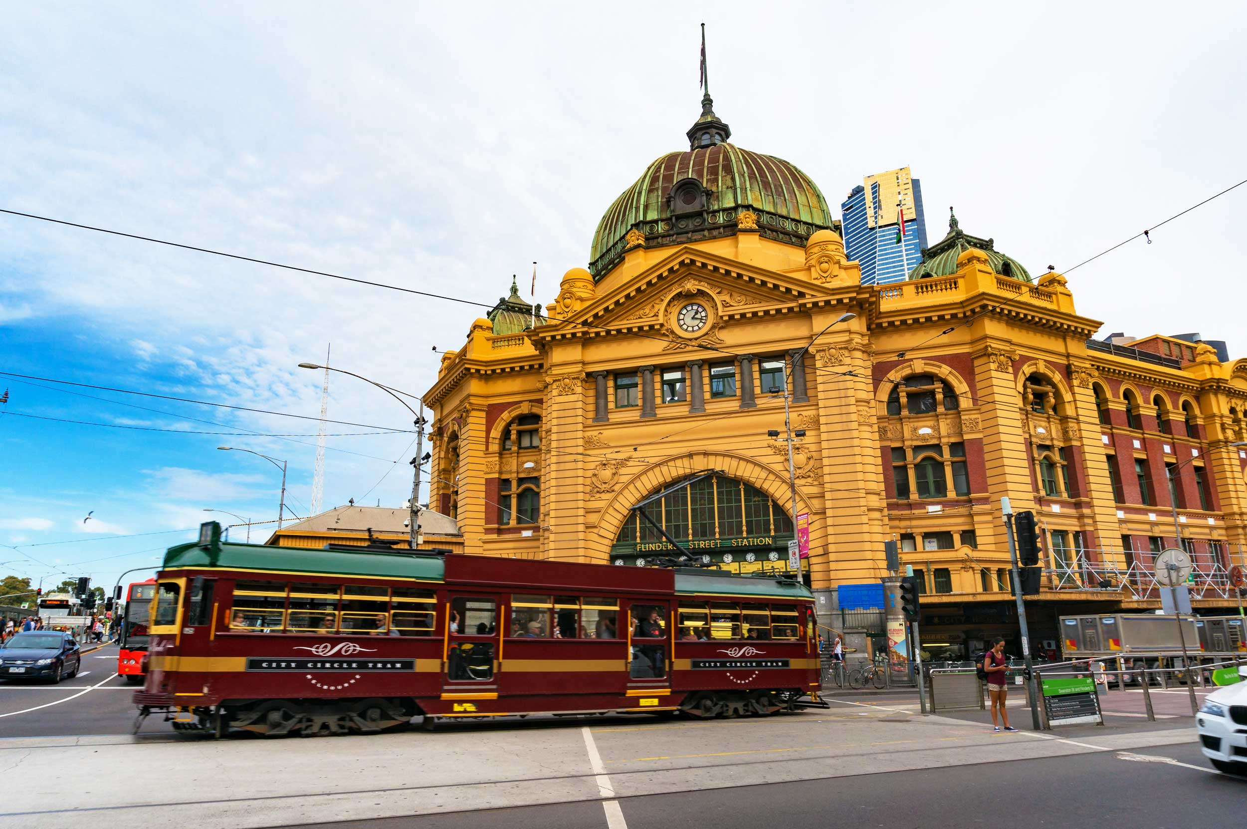 Tram passing a historic domed building, Melbourne