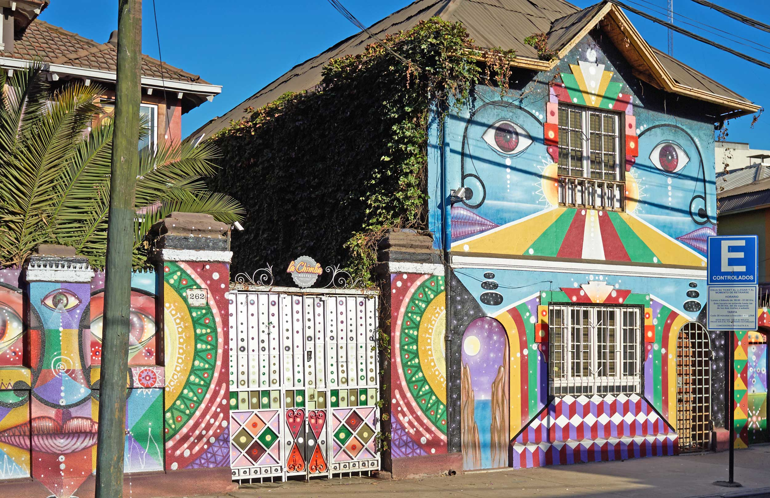A brightly painted mural on a house wall, Santiago