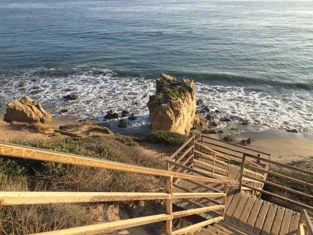 Wooden steps leading down to the beach at El Matador, Malibu