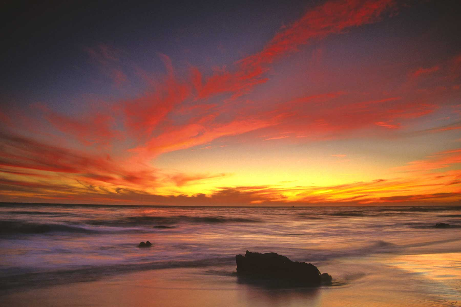 Colourful orange, yellow and purple sunset in the Pacific Ocean, Malibu