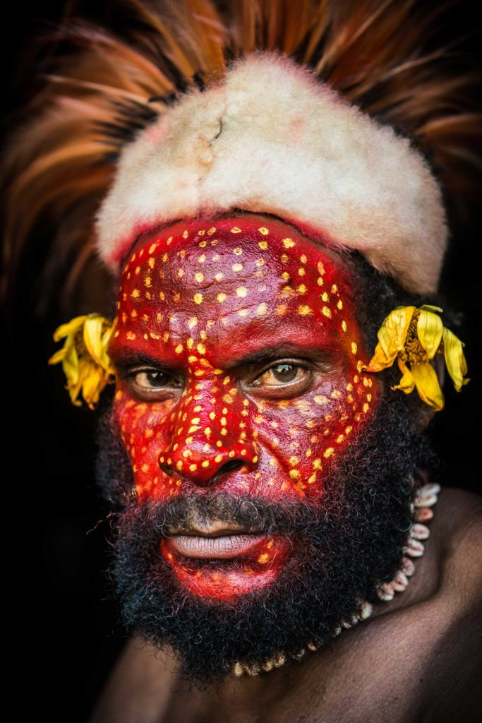 Foi tribesman from the Southern Highlands province located in the centre of Papua New Guinea. For special occasions, the Foi men paint their faces with Digaso oil produced by the kara'o tree. This viscous black oil is mixed with charcoal and plant dyes and used as body paint for ceremonies and rituals. The colour black is traditionally reserved for warriors, red for mature men and yellow for initiates.