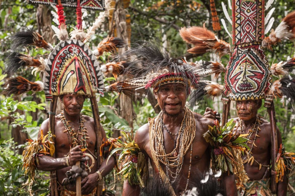 Men from the remote Gulf province of Papua New Guinea wearing large and intricately decorated headgear and masks, the trademark of the Gulf people. The masks come in different styles, shapes and colours. They are made out of a cane framework covered with bark cloth known as tapa.