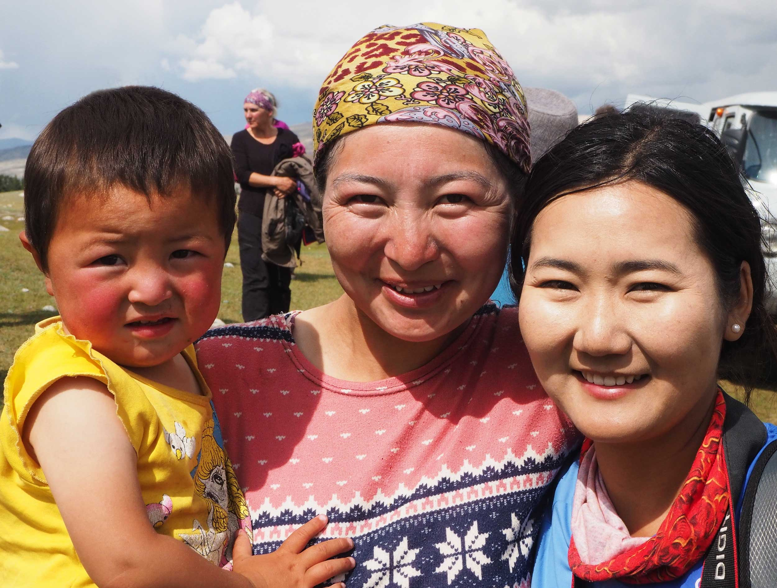 Two smiling Mongolian women with baby