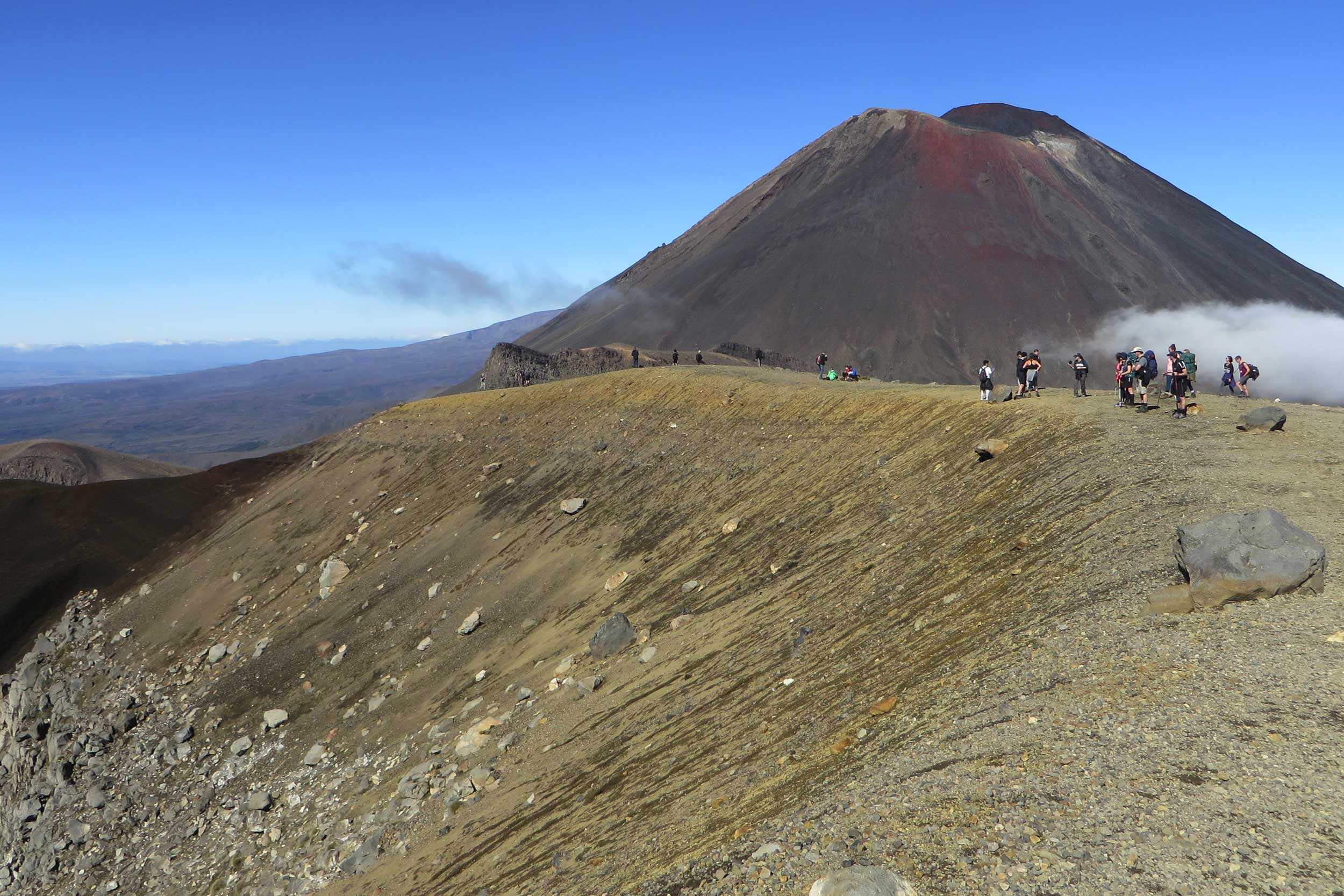 Walkers standing on a ridge, Tongariro Crossing, New Zealand